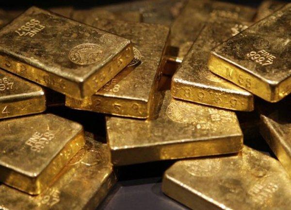 Цените на златото се оттеглиха от осемседмичен връх