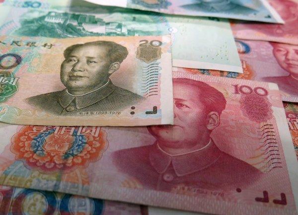 Китайският юан с най-ниската си стойност спрямо долара за десетилетие